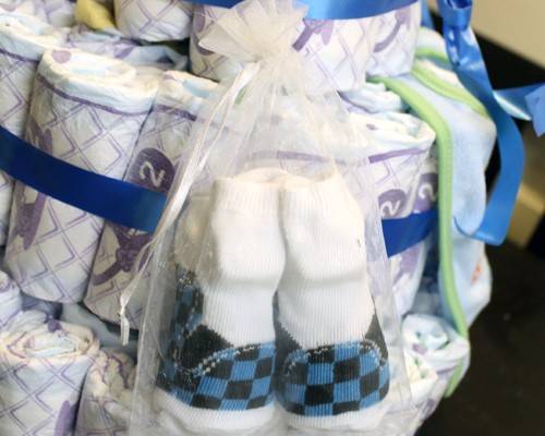 I found these cute little racing booties and hooked the bag right on one of the diapers so it kind of dangles off the side of the cake